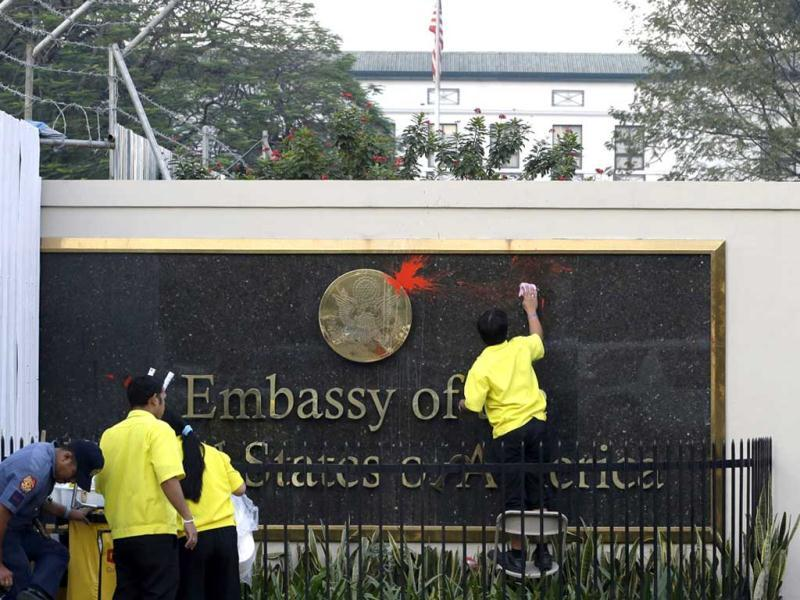 Workers wipe the paint off the seal of the US Embassy in Manila which was thrown by protesters in a rally. The protest was in response to the alleged destruction of the coral reef by the USS Guardian, a US minesweeper, which ran aground last week off Tubbataha Reef, a World Heritage Site, southwest of the Philippines. AP Photo