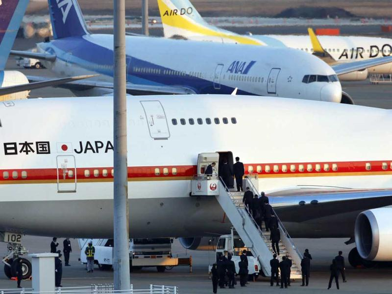 The Japanese government plane carrying the bodies of nine Japanese victims and seven Japanese survivors in last week's hostage taking at the Algerian gas plant, arrives at Haneda Airport in Tokyo. AP Photo