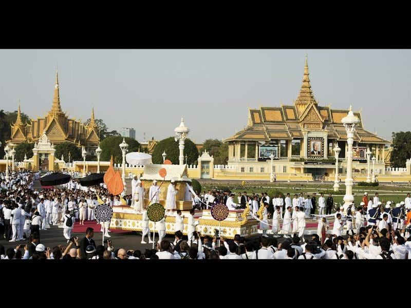 The coffin of the late former King Norodom Sihanouk is seen during his funeral procession in front of the Royal Palace in Phnom Penh. AFP/Nicolas Asfouri