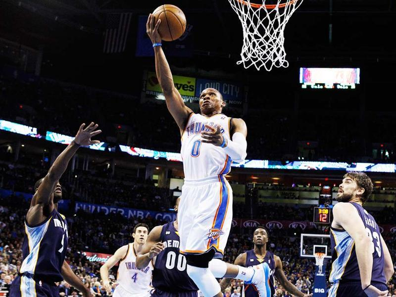 Oklahoma City Thunder guard Russell Westbrook shoots between Memphis Grizzlies guard Tony Allen (9), forward Darrell Arthur (00) and center Marc Gasol (33) in the second quarter of an NBA basketball game in Oklahoma City. AP/Sue Ogrocki