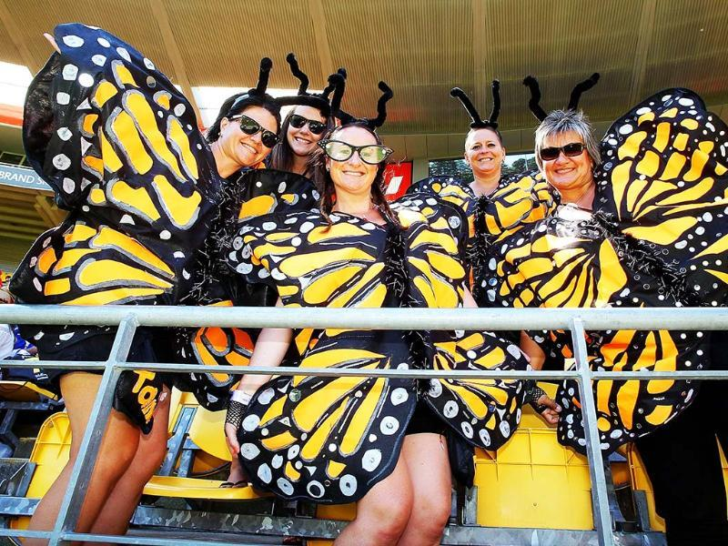 Sevens fans enjoy the atmosphere at the Westpac Stadium at the fourth leg of the IRB Sevens World Series in Wellington. AFP/Marty Melville