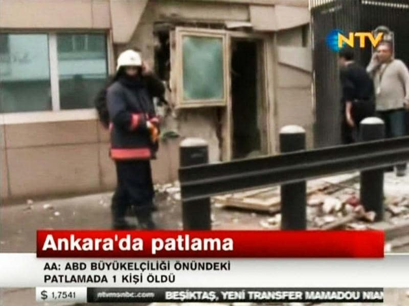 In this image made from video, emergency personnel are seen in front of a side entrance to the US Embassy following a blast, Ankara, Turkey. AP/NTV