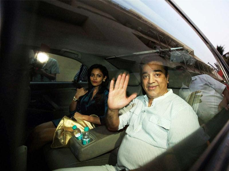 Kamal Haasan looks visibly relaxed as he leaves with actress Pooja Kumar after addressing a press conference in Mumbai. The Hindi version of Kamal Haasan's controversial film, Vishwaroop, was released on Friday. (PTI Photo)