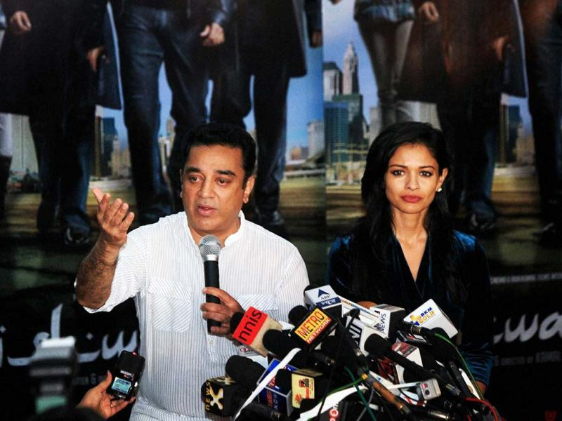 Actor-director Kamal Haasan looks sad as he addresses a press conference in Mumbai with actress Pooja Kumar on January 31, 2013. Kamal Haasan was addressing media after facing wide-spread protests against his film Vishwaroopam.(PTI Photo)