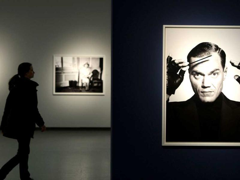 Visitors look at photographs taken Bryan Adams at the Museum NRW forum in Duesseldorf, Germany. AFP