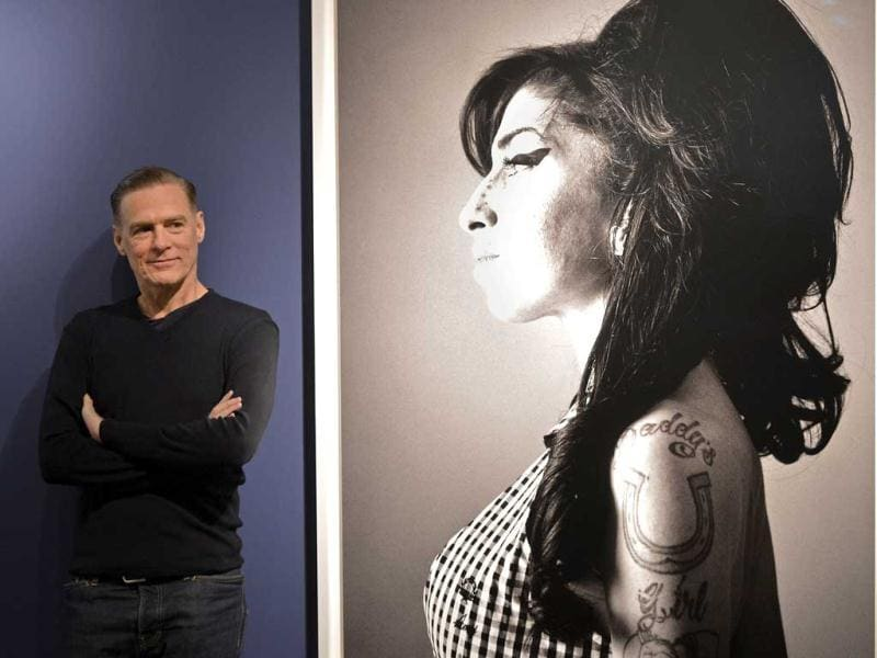 Bryan Adams stands beside of one of his photo prints showing British singer Amy Winehouse during the opening of his exhibition in Duesseldorf, Germany. AP