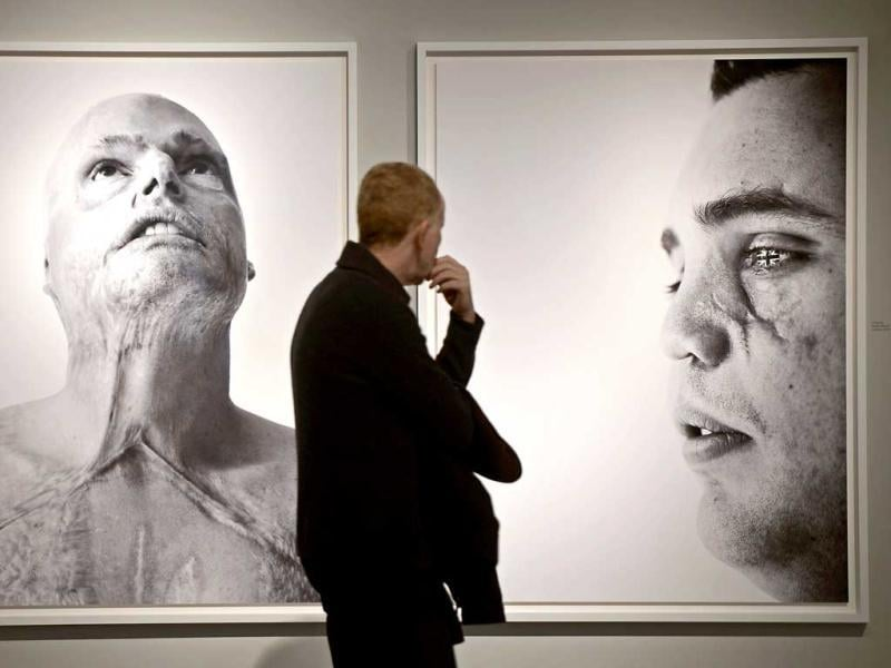 A visitor watches a pictures of British war veterans photographed by Bryan Adams during the opening of his exhibition in Duesseldorf, Germany. AP