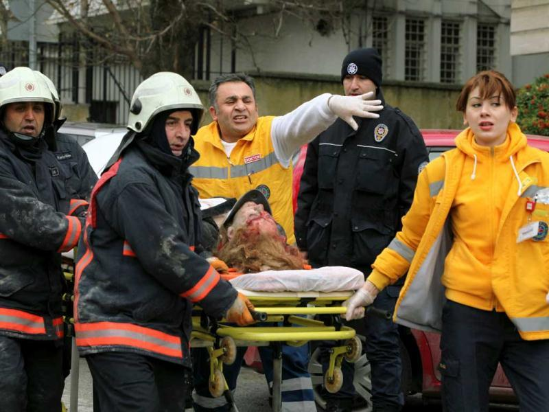Medics carry an injured woman on a stretcher to an ambulance after a suspected suicide bomber detonated an explosive device at the entrance of the US Embassy in Ankara. AP