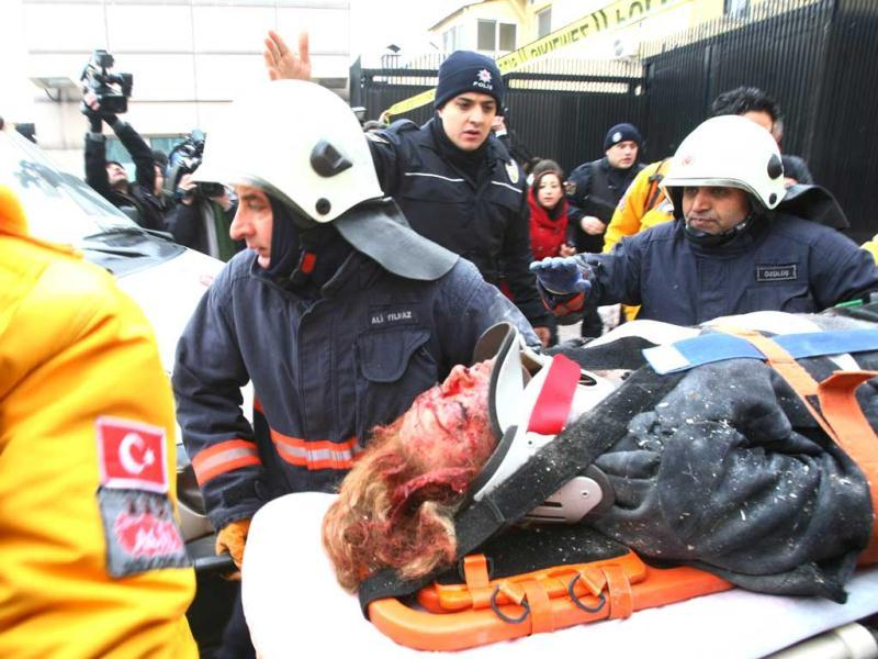 Rescuers take a victim of a blast outside the US Embassy in Ankara to a waiting ambulance. AFP