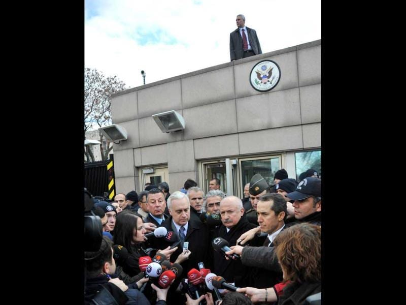 US ambassador to Turkey Francis J Ricciardone (C, L) and provincial governor Alaaddin Yuksel (C, R) give a press point at the site of a blast outside the US Embassy in Ankara. AFP
