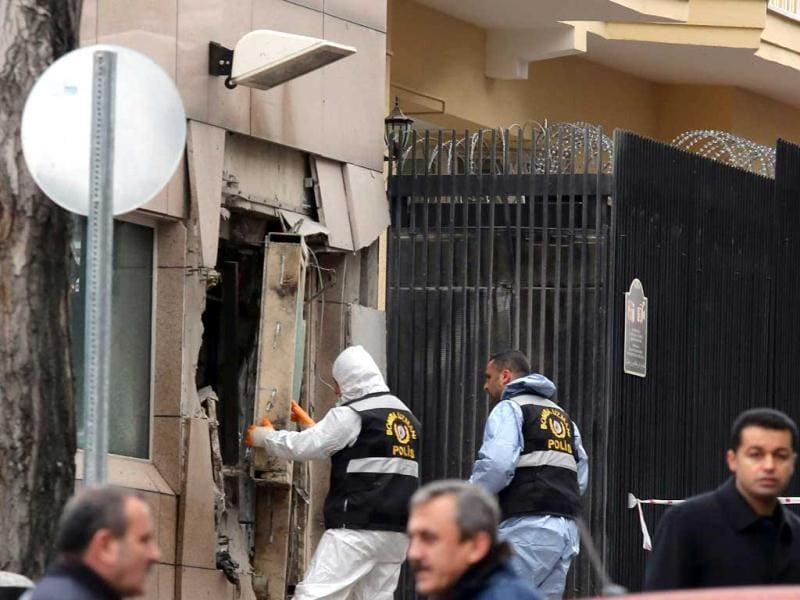 Turkish police bomb experts inspect the site after an explosion at the entrance of the US embassy in Ankara. Reuters