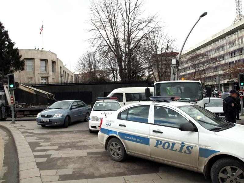Security cars surround the US Embassy in Ankara, after a suspected suicide bomber detonated an explosive device. AP