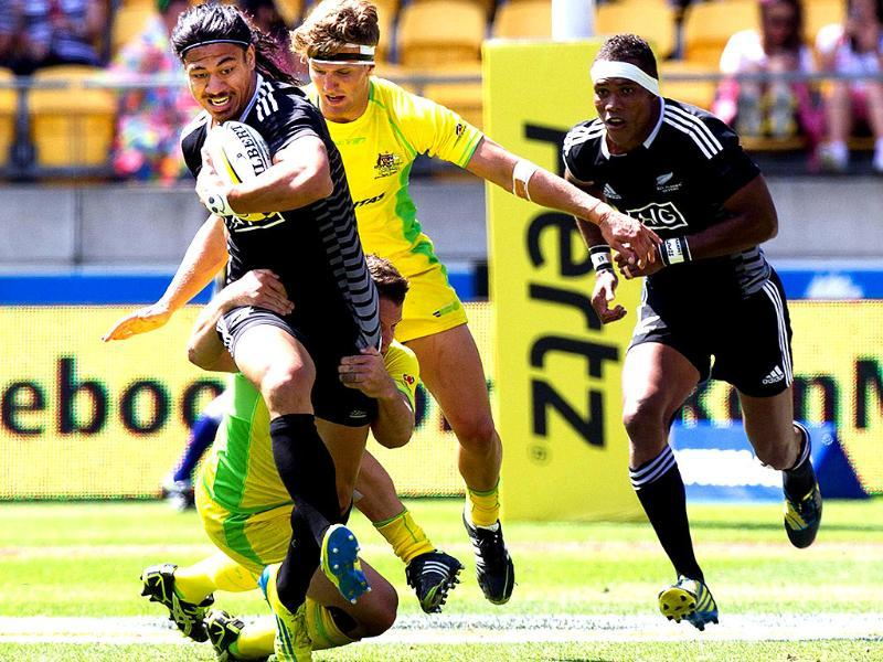 New Zealand's Ben Lam is tackled by Australia's Ben Adams and Lewis Holland with New Zealand's Lote Raikabula in support during their Cup Quarter Final game at the Westpac Stadium on day two of the fourth leg of the IRB Rugby Sevens World Series in Wellington. AFP/Marty Melville