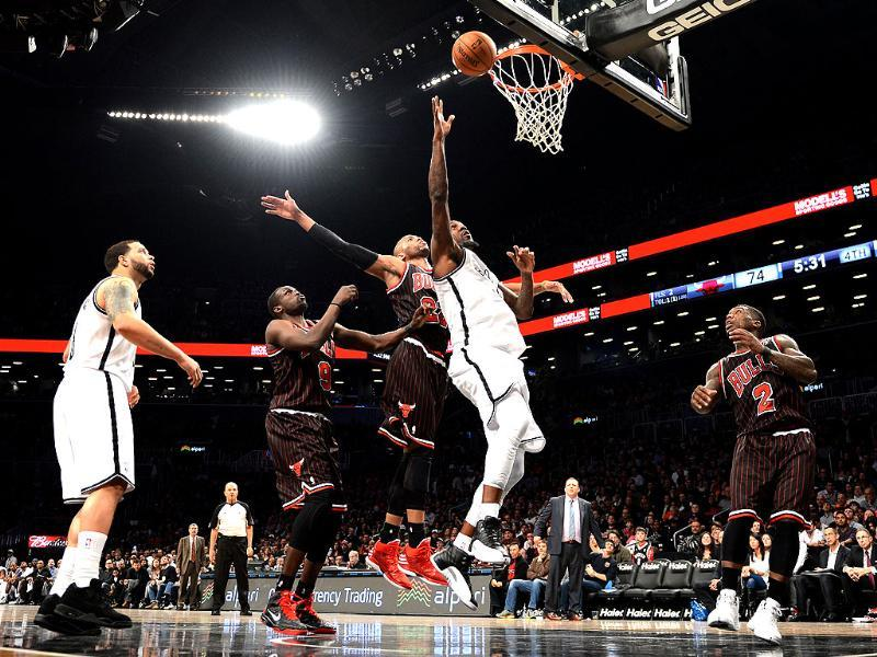 Andray Blatche of the Brooklyn Nets drives against Taj Gibson of the Chicago Bulls during game at the Barclay Center in the Brooklyn borough of New York. AFP/Stan Honda