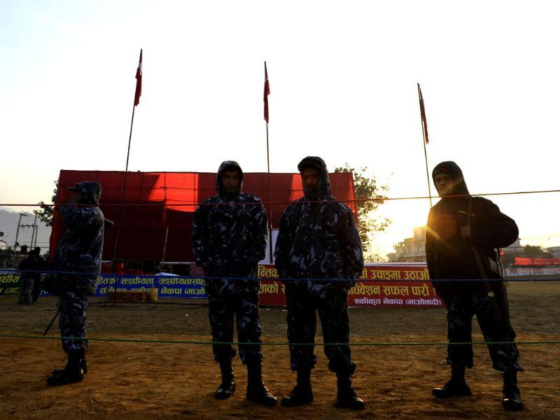 Nepalese police stand guard before the inauguration of the Unified Communist Party of Nepal (Maoist) general convention in Hetauda, some 100 km south of Kathmandu. AFP/Prakash Mathema