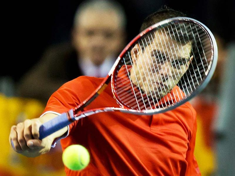 Spain's Guillermo Garcia-Lopez returns to Canada's Milos Raonic during a Davis Cup tennis world group first-round tie singles match in Vancouver, British Columbia. AP Photo