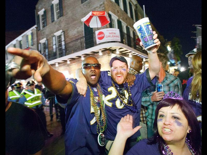 Baltimore Ravens fans celebrate the team's victory as fans from the Ravens and San Francisco 49ers NFL football teams pack the French Quarter on Bourbon Street for Super Bowl XLVII in New Orleans. (AP Photo)