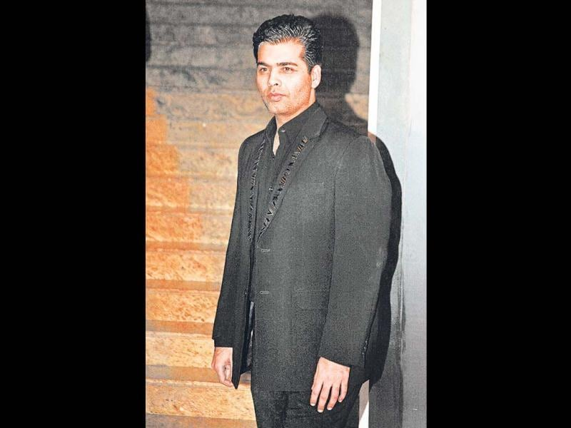 Karan Johar arrives in his favourite black suit at Hyatt in Mumbai for Colors 4th anniversary celebrations.