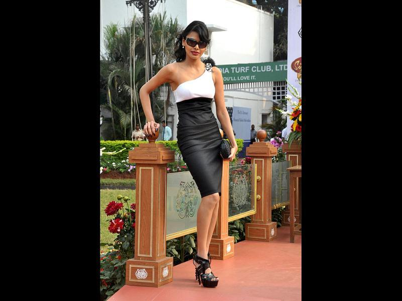 Sherlyn Chopra poses for the photographers at the Mc Dowell's Signature Indian Derby in Mumbai.