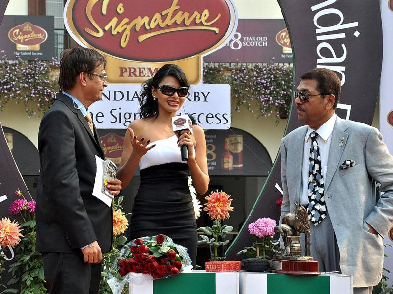 Sherlyn Chopra added the glamour quotient at Dr Vijay Mallya's McDowell Signature Premier Indian Derby, as she stepped out in style at the Mahalaxmi Race Course in Mumbai.