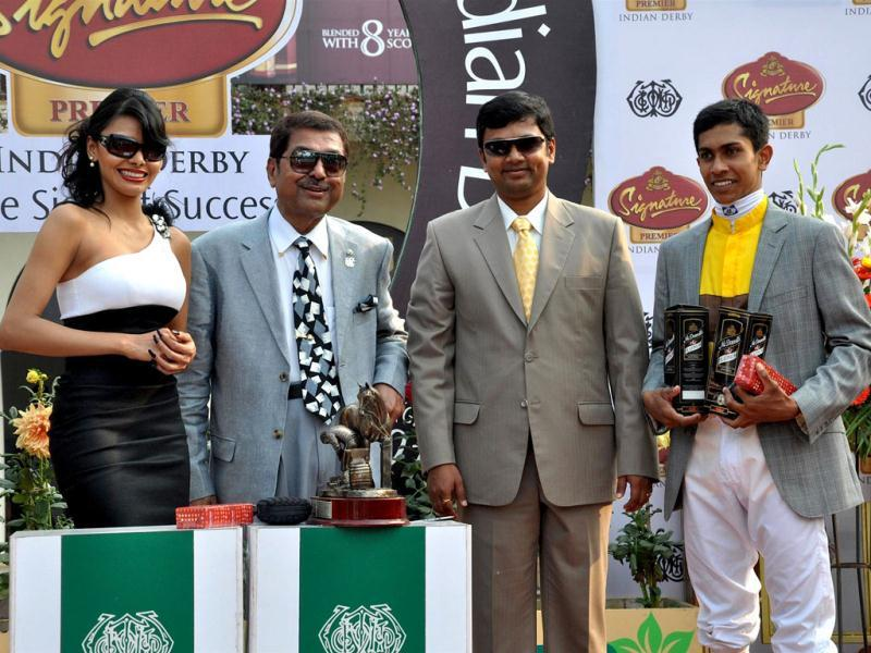 Sherlyn Chopra looks glamorous as she hands over the The McDowell No 1 Platinum Trophy to the winning jockey and the trainer at Indian Derby in Mumbai. She said,
