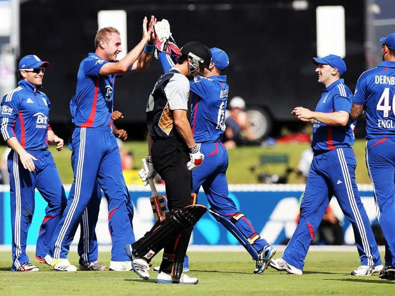 England's Stuart Broad celebrates his hat trick with the wicket of New Zealand's Matthew Henry during the warm up Twenty20 cricket match between the New Zealand XI and England at Cobham Oval in Whangarei. AFP/Michael Bradley