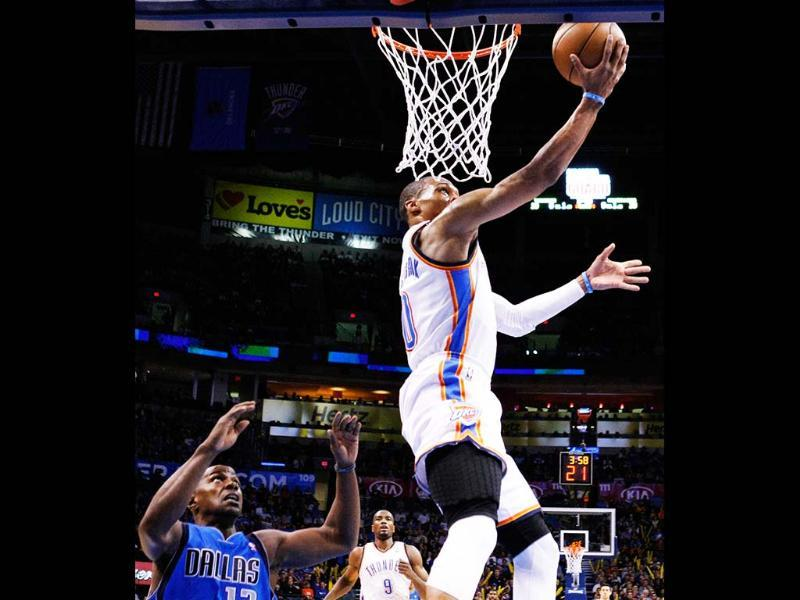 Oklahoma City Thunder guard Russell Westbrook goes to the basket in front of Dallas Mavericks guard Mike James (13) during the first half of an NBA basketball game in Oklahoma City. Oklahoma City won 112-91. AP/Alonzo Adams