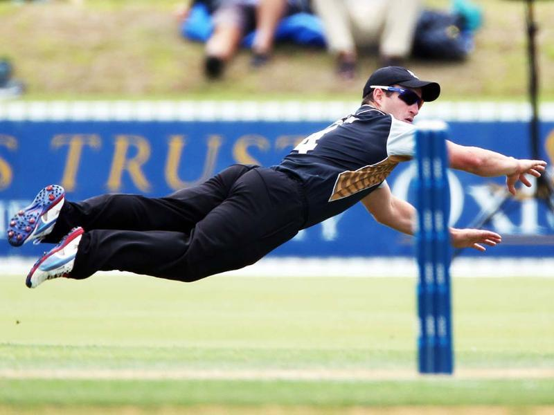 New Zealand's XI's Neil Broom dives for the ball during the warm up Twenty20 cricket match between the New Zealand XI and England at Cobham Oval in Whangarei. AFP/Michael Bradley