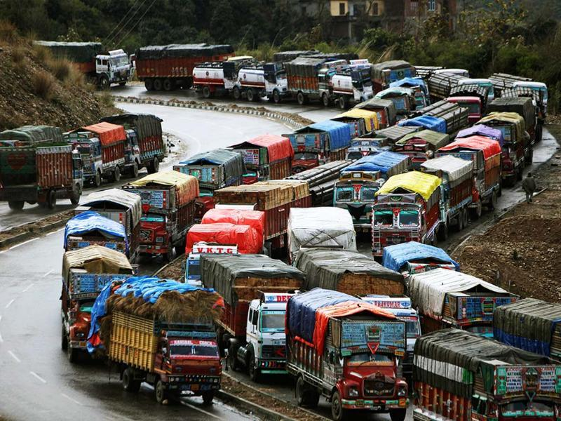 Stranded trucks wait for the Jammu-Srinagar highway to reopen on the outskirts of Jammu. Following fresh snowfall and landslides in some areas, the Srinagar-Jammu highway remained closed for the second consecutive day. AP/Channi Anand