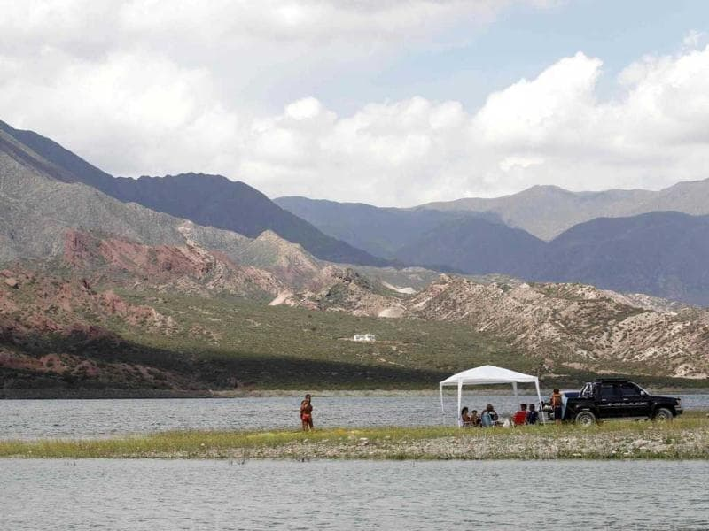 Tourists camp on the edge of the lake of the Potrerillos district about 1,300 meters (4,265 feet) above sea level of the Andean Argentine province of Mendoza. (Reuters)