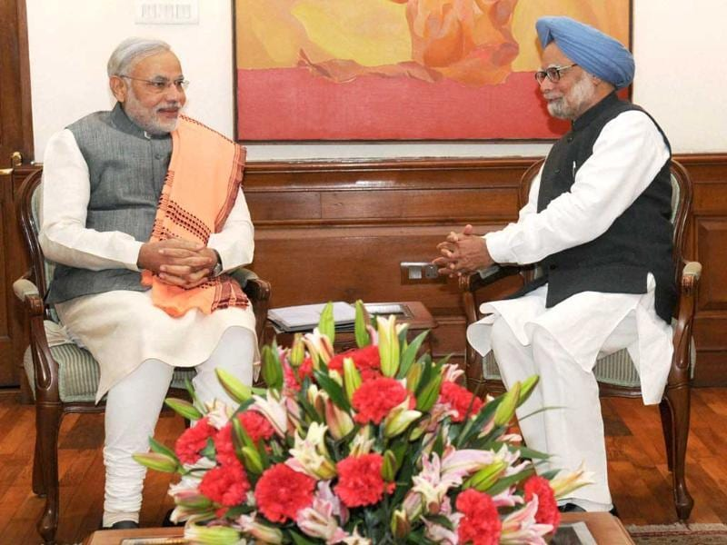 Prime Minister Manmohan Singh meets Gujarat chief minister Narendra Modi at his residence in New Delhi. PTI