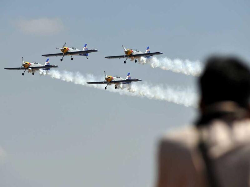 Members of The Flying Bulls aerobatics team from the Czech Republic fly in formation in their Zlin Z-50 aircraft during Aero India 2013 at the Yelahanka Air Force station in Bangalore. AFP