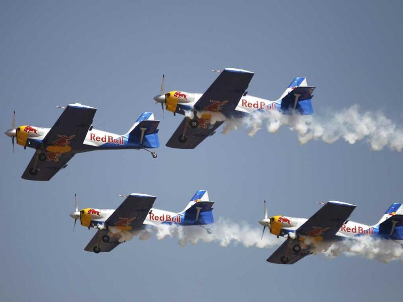 Flying Bulls Zlin 50LX single-engine and single-seater aerobatic display team from the Czech Republic perform on the opening of the Aero India 2013 at Yelahanka air base in Bangalore. AP