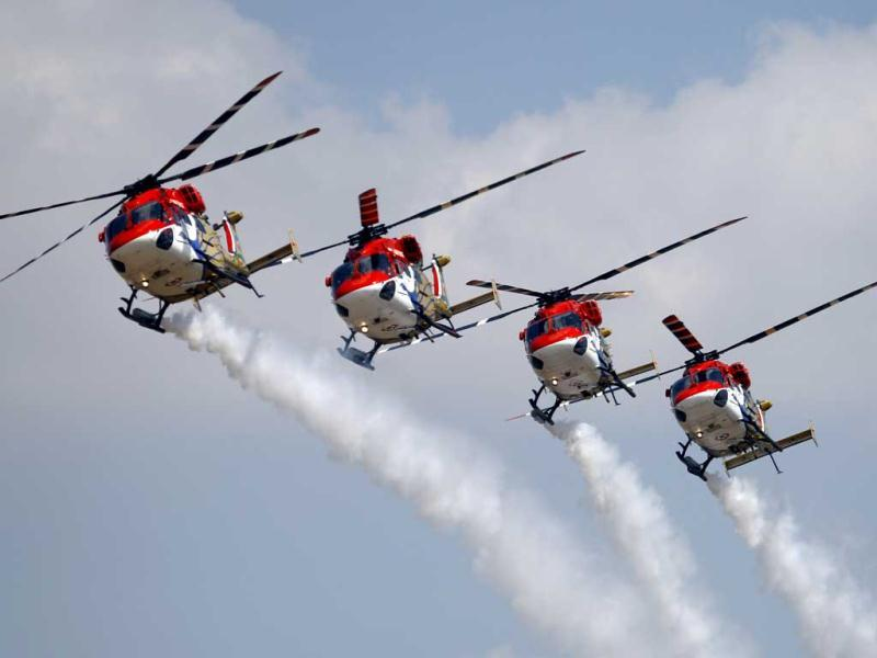 Indian Air Force helicopters perform aerobatic flight on the opening of the Aero India 2013 at Yelahanka air base in Bangalore. AP