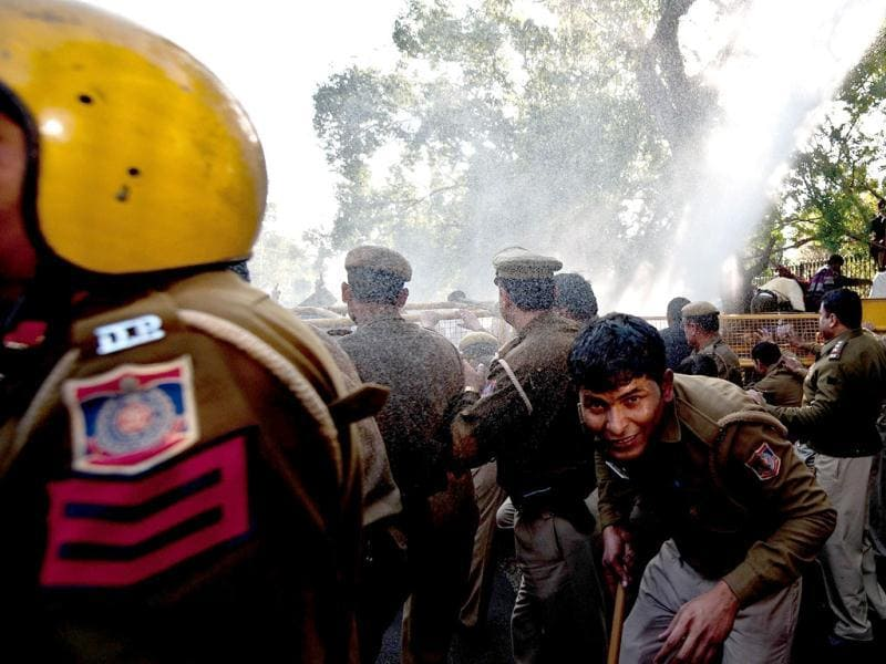 Police fired water cannon at hundreds of students outside Sri Ram College of Commerce in New Delhi who were protesting an appearance by Gujarat chief minister Narendra Modi. AFP