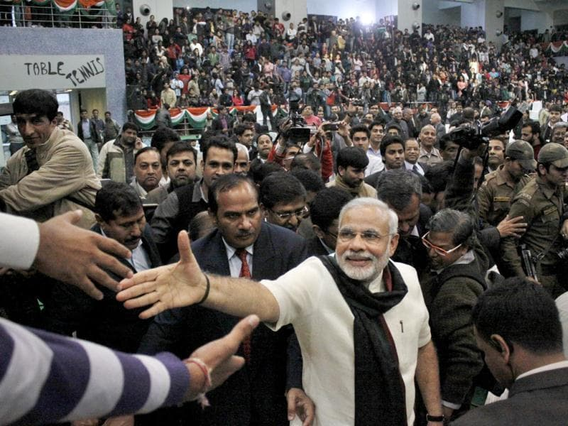 Gujarat CM Narendra Modi waves to students at the annual