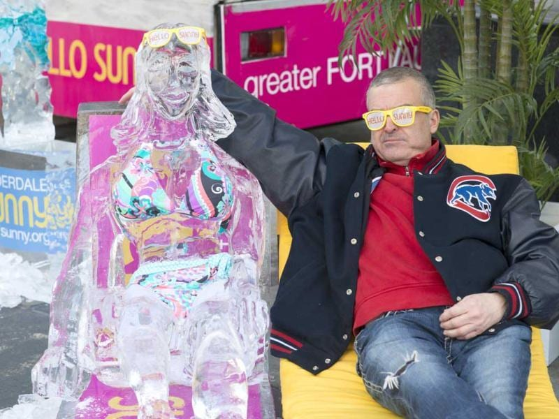 Passerby Robert Heyde gets the cold shoulder as the Greater Fort Lauderdale Convention & Visitors Bureau says goodbye chilly, Hello Sunny today on Michigan Avenue in Chicago with their Hello Sunny campaign. AP