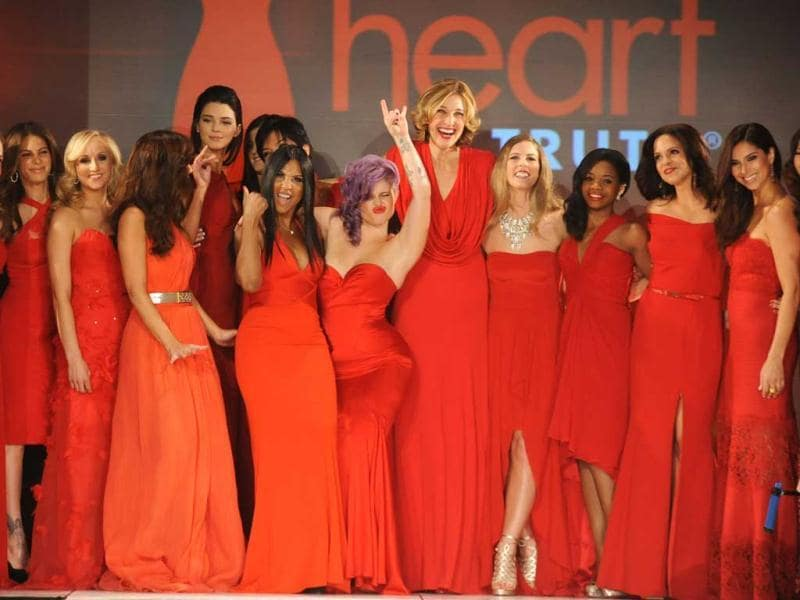 (L-R) Wendy Williams, Cindy Parsons, Nastia Liukin, Minka Kelly, Kendall Jenner, Kylie Jenner, Toni Braxton, Kelly Osbourne, Brenda Strong, Torah Bright, Gabrielle Douglas, Soledad O'brien, Roselyn Sanchez, Jamie Chung and Savannah Guthrie on the runway during The Heart Truth 2013 Fashion Show held at the Hammerstein Ballroom in New York City. AFP