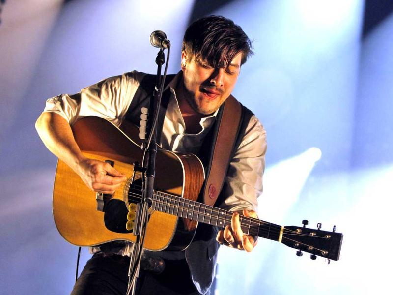 Lead singer Marcus Mumford performs with Mumford & Sons during a concert at the Barclays Center in New York. AP