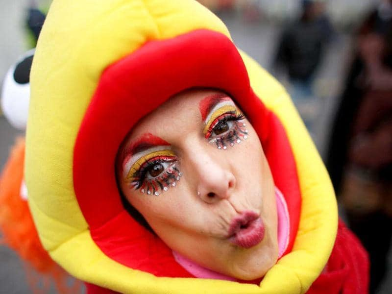 A fool celebrates the beginning of the street carnival in Cologne, western Germany as the hot carnival season was launched. Hundreds of thousands of Germans, mainly in the western Rhine region, crowd the streets to celebrate Women's Carnival Day. AFP Photo