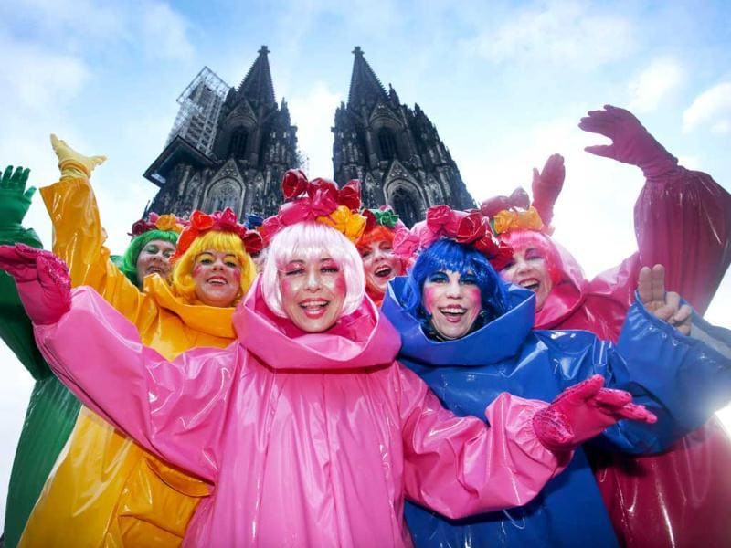 Fools standing in front of Cologne's landmark, the Cathedral, celebrate the beginning of the street carnival in Cologne, western Germany as the hot carnival season was launched. AFP Photo