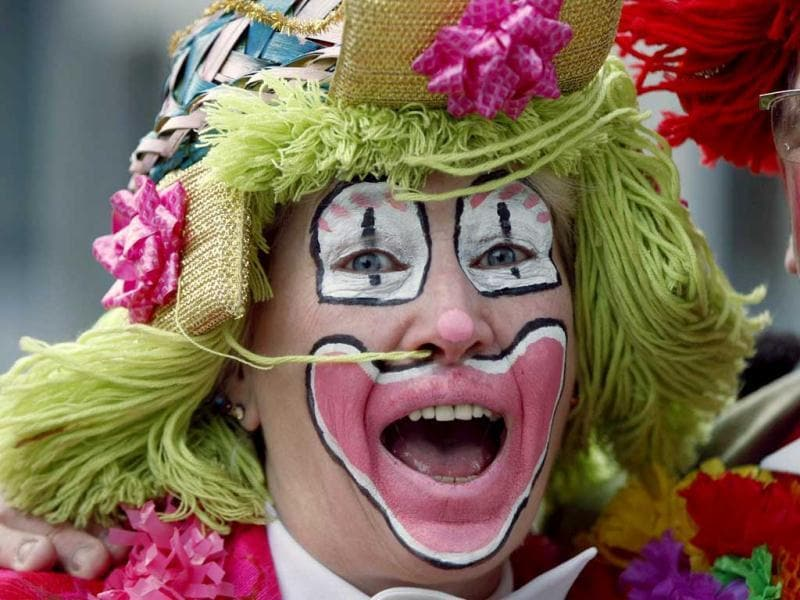 A woman dressed as clown celebrates