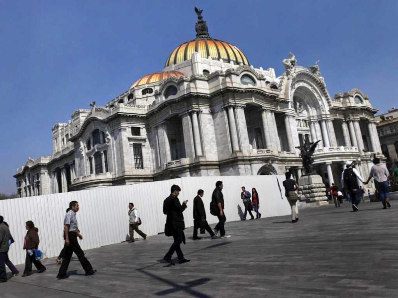 People walk in front of the Palace of Fine Arts in Mexico City. Reuters