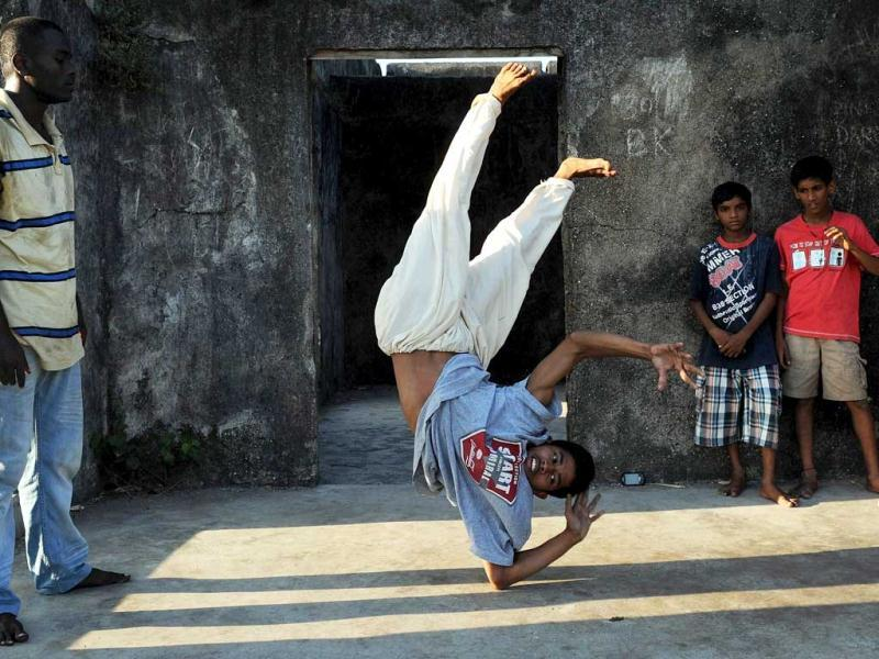 Dancers, a group of breaking or 'b-boying' dancers, takes part in a practice session at the Sion fort in Mumbai. AFP