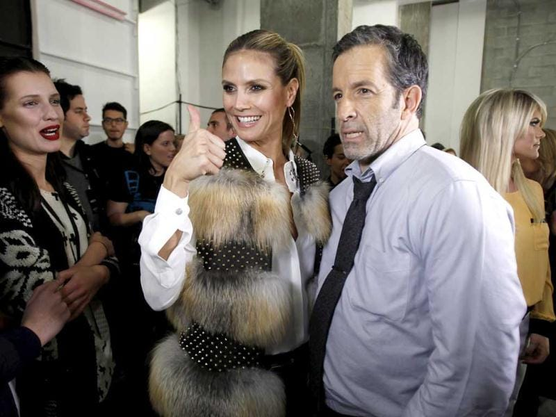 Supermodel Heidi Klum and designer Kenneth Cole pose for a photo before the Kenneth Cole Autumn/Winter 2013 collection during New York Fashion Week in New York. Reuters