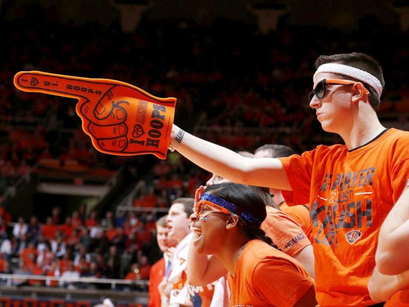 Illinois Fighting Illini fans cheer against the Indiana Hoosiers during the game at Assembly Hall in Champaign, Illinois. Illinois defeated No. 1 ranked Indiana 74-72. AFP