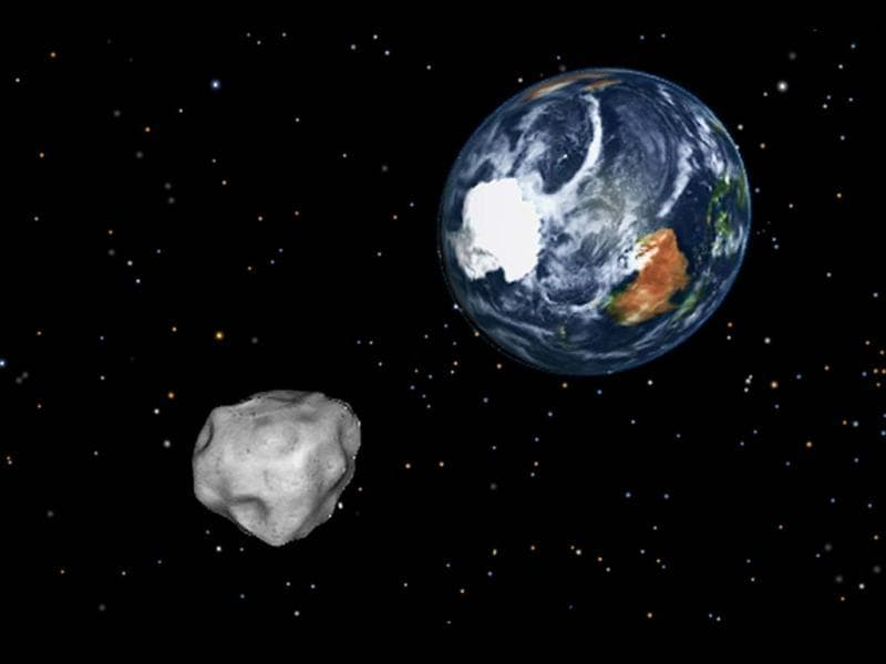 A simulation of asteroid 2012 DA14 approaching from the south as it passes through the Earth-moon system on Feb. 15, 2013. The 150-foot object will pass within 17,000 miles of the Earth. AP/NASA/JPL-Caltech