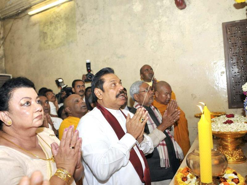 Sri Lankan President Mahinda Rajapaksa and his wife visit the world heritage Mahabodhi temple in Bodhgaya. PTI