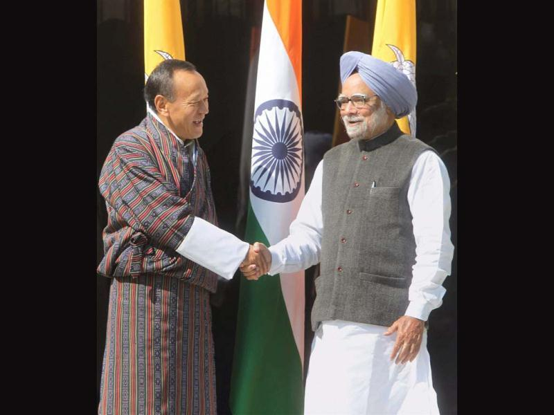 Prime Minister Manmohan Singh shakes hands with his Bhutanese counterpart Lyonchen Jigme Yoser Thinley during a meeting in New Delhi. PTI/Vijay Kumar Joshi