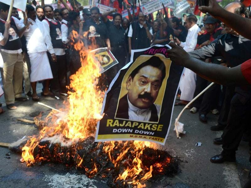 MDMK activists burn an effigy of Sri Lankan President Mahinda Rajapakse against his visit to India during a protest in New Delhi. AFP/Raveendran